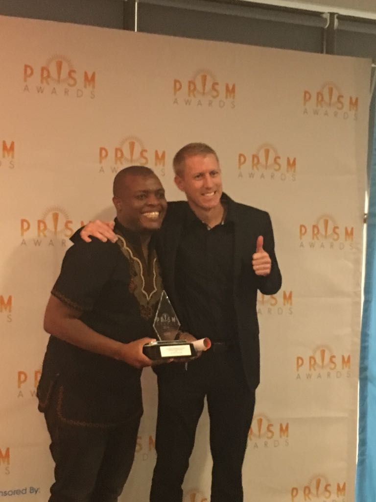 Kevin and Peter winning at the 2018 PRISM Awards for work done for SAP